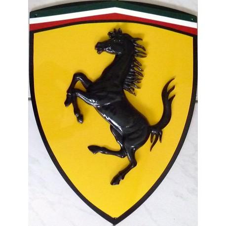 metal shield with ferrari logo formulasports